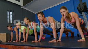 Group of people working out together in a row