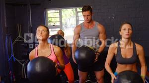 Group of people exercising with ball