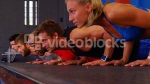 Group of people performing push-up exercise