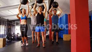 Group of people exercising with exercise ball