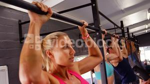 Group of people performing pull-up exercise