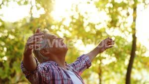 Senior man with arms outstretched