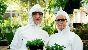 Female scientists holding pot plant