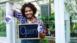 Happy man holding open sign