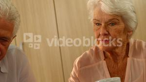 Thoughtful senior woman with a cup of coffee