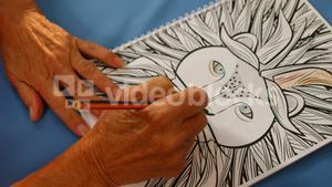 Senior woman drawing with a pencil