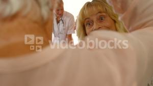 Senior woman talking to each other while female doctor talking to men