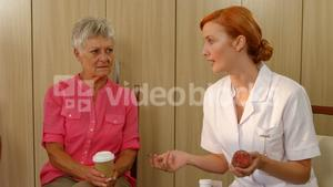 Therapist talking to two senior women