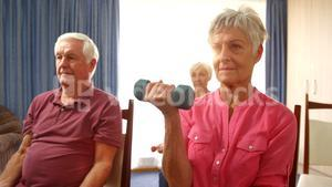 Group of senior people exercising with dumbbells