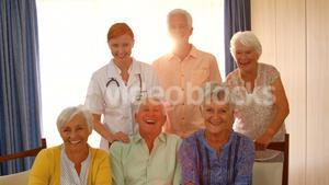 Group of happy senior people and doctor