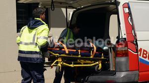 ambulance team carried the injured woman away on stretchers
