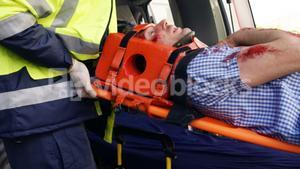Emergency medical technicians holding a wounded person