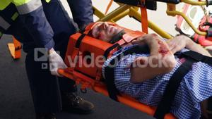 Close up of emergency medical technician holding a wounded person