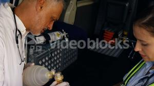 Emergency medical technician placing an oxygen mask