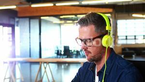 Man listening to music while working on computer