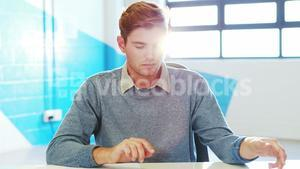 Man using digital tablet and looking at documents