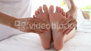 Close up of woman therapist massaging the feet of her patient