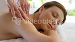 Close up of woman therapist massaging the shoulders of her patient