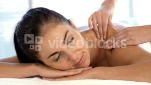 smilling woman getting a back massage