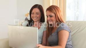 Cheering women with a laptop
