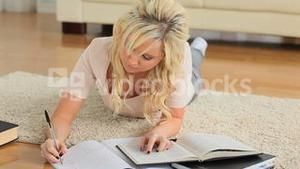 Cute woman learning on the floor