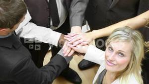 Panorama of business people with hands together