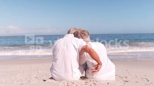 Elderly couple hugging on the beach
