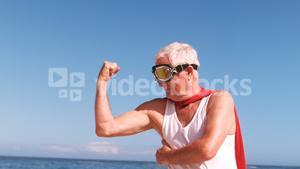 elderly man flexing arms and dressing like superheros