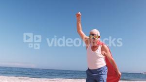 elderly man running with the arms in the air dressed like superheros