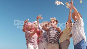 senior friends throwing money in the air