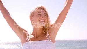 Smiling woman raising her arms