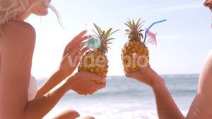 Smiling couple drinking in a pineapple