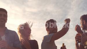 Six people dancing and drinking beers