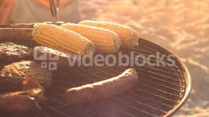 Food cooking on a barbecue