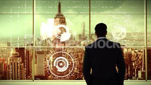 businessman in office with futuristic city background
