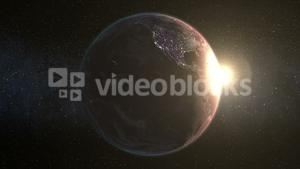animation of spinning earth with sun