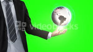 Businessman with globe animation in front of green screen