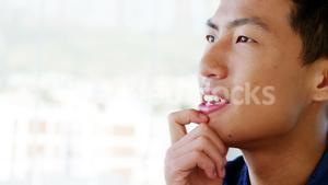 Man contemplating then laughing