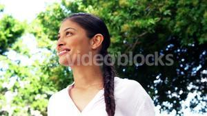 dark haired woman smiling and enjoying outdoors