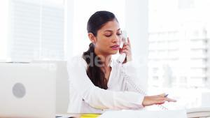 Woman in office making call