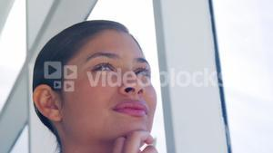 contemplating woman looking out office window
