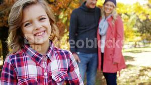 family with dog outdoors