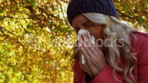 Woman is blowing her nose