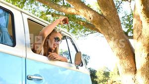 Hipster woman looking out of window of the van