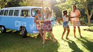 hipster friends playing music and dancing