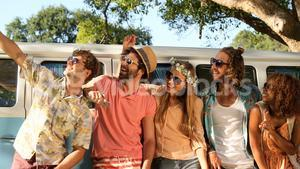 Group of hipster friends taking a selfie