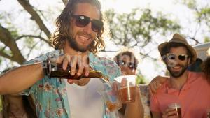 Group of hipster friends drinking beer