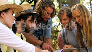 A group of hipster friends pointing maps