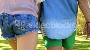 Rear view of a couple holding hands