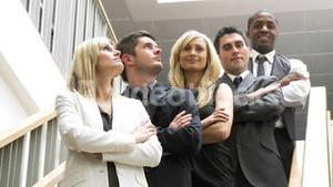 Business people in a line on stairs smiling at the camera